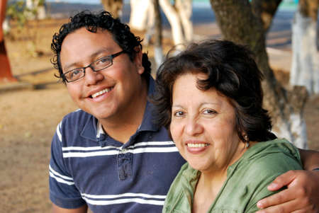 three generations of women: Hispanic mother and grown son