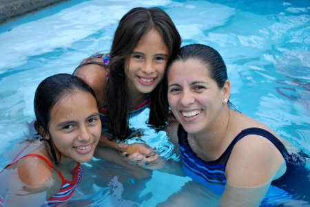 Beautiful Hispanic mother with her two daughters photo