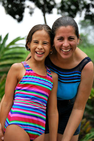 scrunch: Beautiful Hispanic mother and daughter smiling