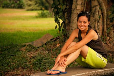Beautiful Hispanic Woman relaxing in nature photo