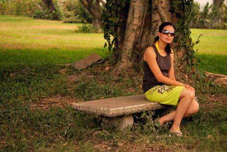 Beautiful Hispanic woman posing outside photo