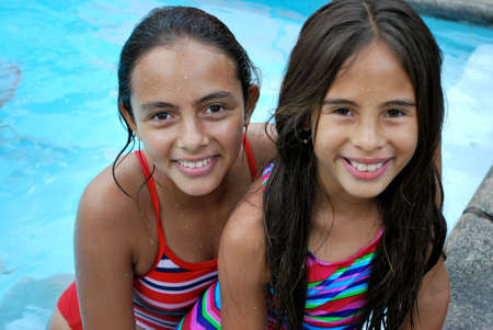 hispanics mexicans: Beautiful Hispanic sisters by the pool