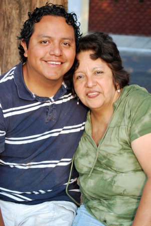 aged: Middle aged Hispanic mother and grown son Stock Photo