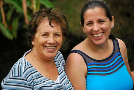 Hispanic mother with grown daughter