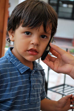 Young boy talking on cell phone photo