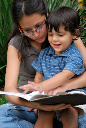 hispanic mother: Young Hispanic mother reads with her son