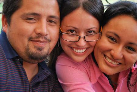 The faces of three Hispanic friends photo