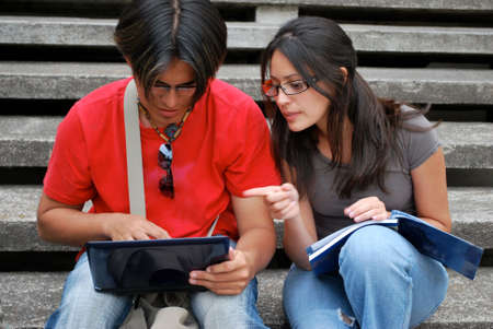 Hispanic college students studying together