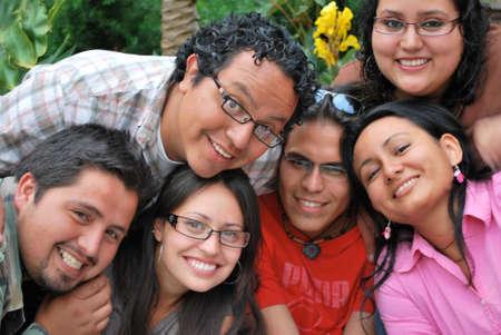study group: Faces of Happy Hispanic students Stock Photo