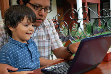Father and son on the computer together