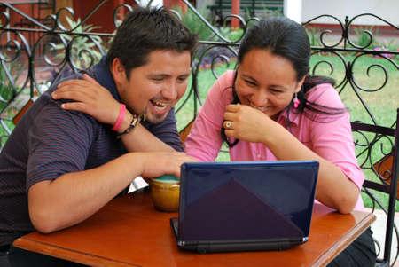 Hispanic couple using the computer photo