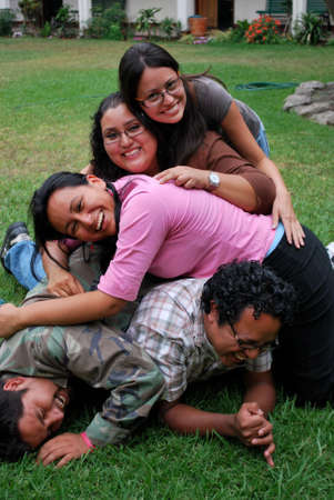 A pile of attractive Hispanic students