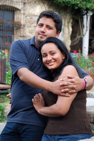 Hispanic Couple hugging photo