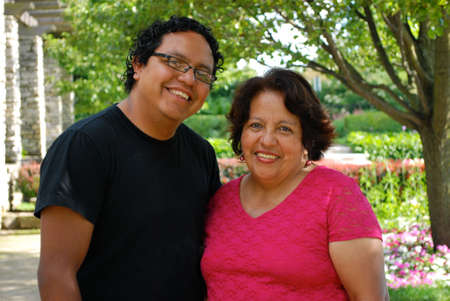 grown: Hispanic mother with her grown son