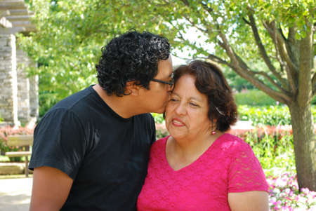 Hispanic mother with her grown son