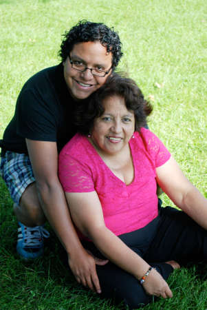 three generations of women: Hispanic mother with her grown son