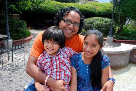 average: Hispanic father with two adorable kids Stock Photo