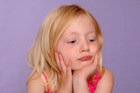 pretty blonde girl looking fed up and bored, isolated on lilac background Stock Photo - 19382094