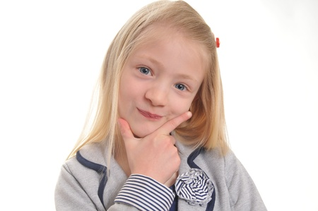 quizzical: chica guapa rubia con expresi�n burlona aisladas sobre fondo blanco Foto de archivo