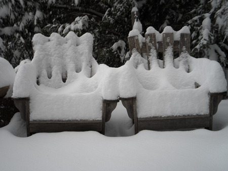 Snow-Covered Adirondack Chairs