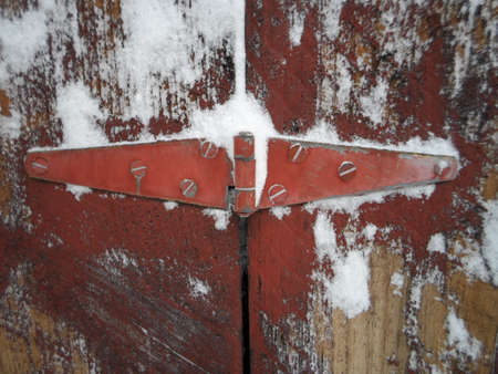Snow on Wooden Red Door Latch