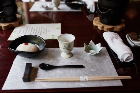 Course of simmering tofu.  One part of a multi-course, traditional Kaiseki meal in Kyoto, Japan Imagens