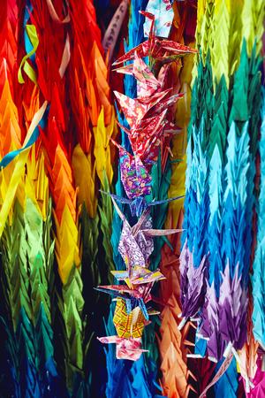 Paper cranes origami hanging in Hiroshima at the Childrens Memorial Peace Park in Japan