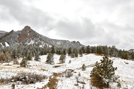 A Spring snow storm covers the mountain range, valley and Flatirons of Chautauqua Park, in Boulder, Colorado.