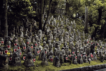 Rows of Jizo stone statues on a hillside in Kyoto, Japan at the Kiyomizu-Dera Temple Editorial