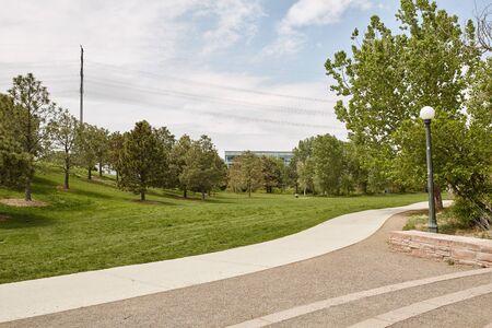 Path through Confluence Park, part of the Riverfront Park neighborhood in downtown Denver, Colorado Imagens