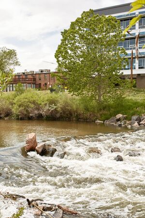 Condos and highrise buildings near Platte River at Confluence Park in the Riverfront Park neighborhood of Denver, Colorado