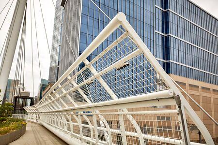 Closeup of Millennium Bridge structure at the Riverfront Park neighborhood of Denver. Commons Park Imagens