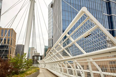 Closeup of Millennium Bridge structure at the Riverfront Park neighborhood of Denver. Commons Park Stock Photo