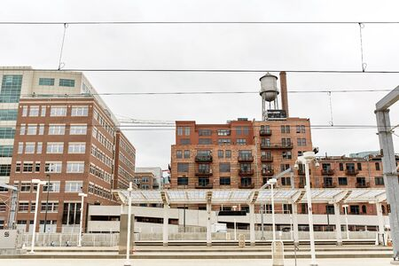 Condominiums and highrise buildings behind train tracks, downtown at Union Station in Denver, Colorado