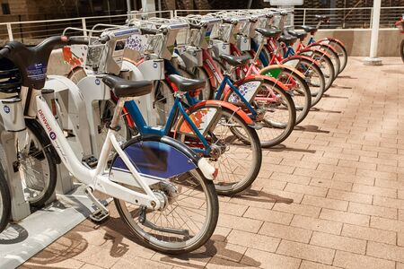 A row of rental bikes on display at the Millennium Bridge in the Riverfront Park neighborhood, downtown Denver, Colorado Editorial