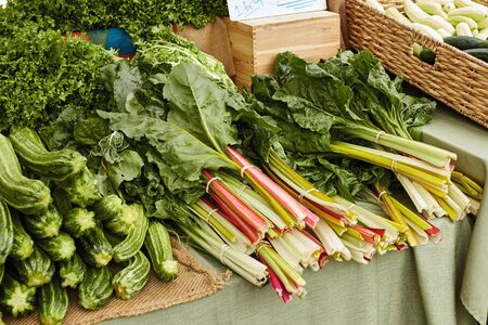Stack of Swiss and Rainbow chard on display at a Farmers Market in Boulder, Colorado