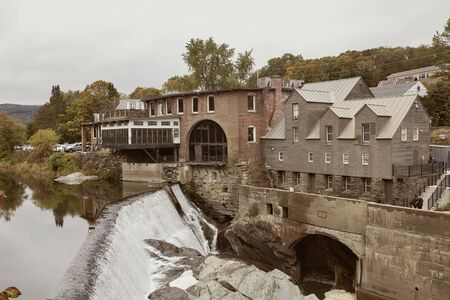 Overlooking Ottauquechee River Falls in the New England town of Quechee, Vermont on a cool, Fall day