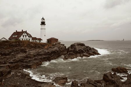 Portland Head Lighthouse on a cold and stormy Fall day in Cape Elizabeth, Maine, USA.
