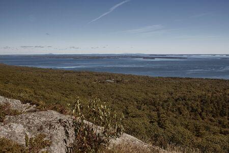 Overlooking Penobscot Bay from the summit of Mt Battie at Camden Hills Stat Park in Camden, Maine.