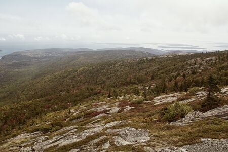 View of Maine coastline in the distance from Cadillac Mountain on Mount Desert Island in Acadia National Park