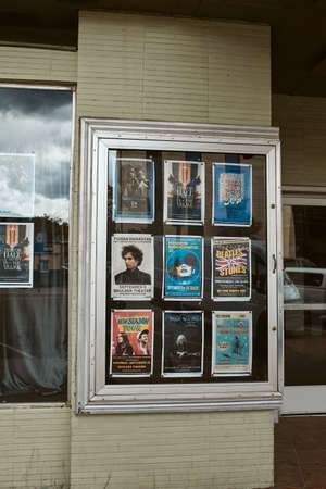 Boulder, Colorado - May 27th, 2020:  Posters of previously scheduled performances at Boulder Theater.  Currently temporarily closed due to Covid-19 pandemic.