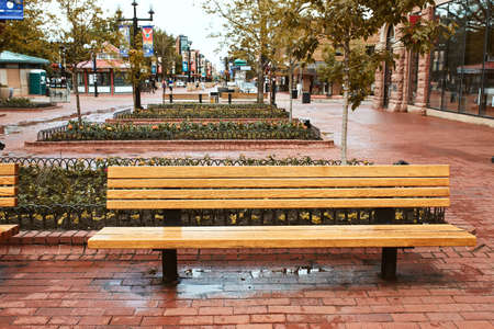 Boulder, Colorado - May 27th, 2020: Park Benches and flowerbeds along Pearl Street Mall, a pedestrian mall in Boulder County