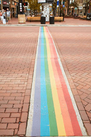 Boulder, Colorado - May 27th, 2020:  Rainbow crosswalk along intersection of Pearl Street Mall to celebrate Pride week