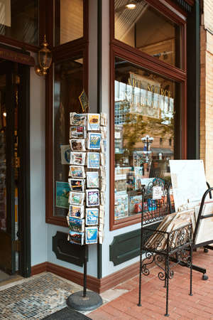 Boulder, Colorado - May 27th, 2020:  Post cards and vintage maps in a store display at Pearl Street Mall.