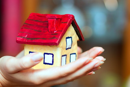 The house in woman hands Stock Photo - 8140636