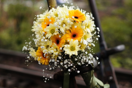 chrysanthemum bouquet on railway