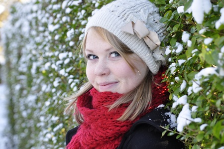Winter blonde in a snowy hedgerow photo