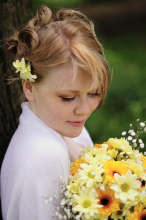 Bridesmaid and yellow chrysanthemum bouquet Stock Photo