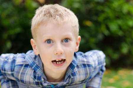 stunned wide-eyed blonde kid leaning forward