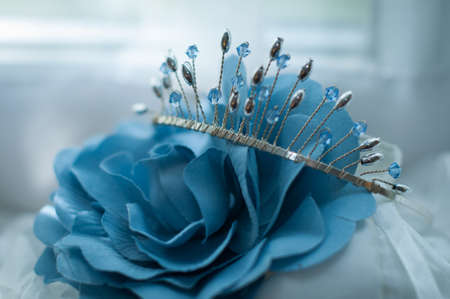 bridal silver and blue tiara and blue rose zoomed in Stock Photo
